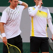 John Peers of Australia (L) talks with team-mate Jamie Murrary of Great Britain during their second round loss to Colombians Juan Sebastian Cabal and Robert Farah on Day 6 at Roland Garros; Getty Images