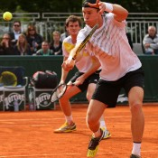 John Peers of Australia plays a volley in his first round doubles win with Jamie Murray of Great Britain over Julian Knowle of Austria and Filip Polasek of Slovakia on Day 4 of the French Open at Roland Garros; Getty Images