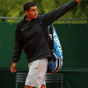 Nick Kyrgios waves farewell after falling 6-4 6-2 6-2 in the second round to No.10 seed Marin Cilic of Croatia on Day 4 of the French Open; Getty Images