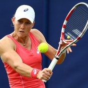 Sam Stosur volleys during her first round win over No.8 seed Nadia Petrova of Russia at the AEGON International in Eastbourne, England; Getty Images