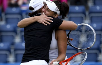 Ash Barty (L) and Casey Dellacqua (R) celebrate after defeating Cara Black and Marina Erakovic in the doubles final of the AEGON Classic in Birmingham, England; Getty Images
