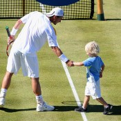 Lleyton Hewitt is joined on court by son Cruz after beating Juan Martin del Potro of Argentina at the AEGON Championships at Queen's Club; Getty Images