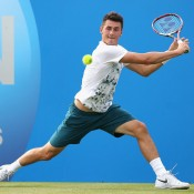 Bernard Tomic stretches for a backhand during his three-set loss to Benjamin Becker of Germany on Day 2 of the AEGON Championships at Queen's Club; Getty Images