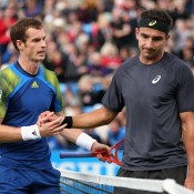 A dejected Marinko Matosevic (R) shakes hands with Andy Murray after falling 6-2 6-2 to the Scot in the third round of the AEGON Championships; Getty Images