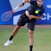 Marinko Matosevic serves during his third round loss to top seed Andy Murray at the AEGON Championships at Queen's Club in London; Getty Images