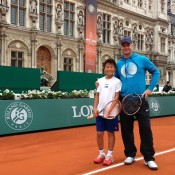 Rinky Hijikata (L) poses with coach Ben Pyne on the match court for the Longines Future Tennis Aces at Hotel de Ville; Tennis Australia