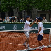 Rinky Hijikata (R) shakes hands with Rudolf Molleker after the German beat him 4-1 4-0 in the quarterfinals of the Longines Future Tennis Aces tournament in Paris, France; Tennis Australia