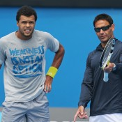 Jo-Wilfried Tsonga with coach Roger Rasheed (R) during a practice session ahead of the 2013 Australian Open at Melbourne Park; Getty Images