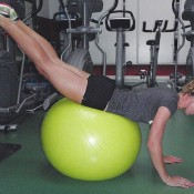 GRASS - PRONE SWISH BALL HIP EXTENSION: 1) Lay face down on a stability ball with hips on the crest of the ball; 2) Arms stay in a slightly flexed position (depending on ball height); 3) Lift legs up and extend hips until the back is in a straight position, then return to the start (pictured); 4) Keep feet together and maintain straight legs; 5) Complete three of eight to 10 repetitions.