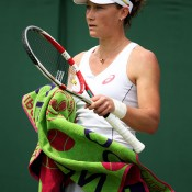 Sam Stosur towels off during her first-round win over Anna Schmiedlova. GETTY IMAGES