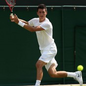 Bernard Tomic on his way to a five-set win in the first round. GETTY IMAGES