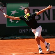 Jay Andrijic of Australia reaches for a forehand during his boys' singles first round match against Hyeon Chung of Republic of Korea on Day 8 of the French Open at Roland Garros in Paris, France; Getty Images