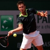 Jay Andrijic, playing a forehand in his boys' singles first round match against Hyeon Chung of Korea, went down 6-3 6-1; Getty Images