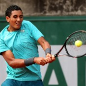Nick Kyrgios plays a backhand in his boys' singles first round match against Maxime Janvier of France on Day 8 of the French Open at Roland Garros, a match he won in straight sets; Getty Images