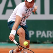Bradley Mousley plays a backhand during his 6-1 4-6 6-4 victory over Marcelo Zorman Da Silva of Brazil in his boys' singles first round match at the French Open; Getty Images
