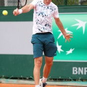 Bradley Mousley exhibits a classic one-handed backhand en route to victory over Marcelo Zorman Da Silva of Brazil in the first round of the boys' singles on Day 8 of the French Open at Roland Garros; Getty Images