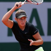 Sara Tomic of Australia plays a forehand in her girls' singles first round match against Jana Fett of Croatia on Day 8 of the French Open at Roland Garros; Getty Images