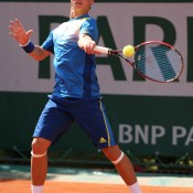Omar Jasika plays a forehand during his 6-1 6-1 loss to Nikola Milojevic of Serbia on Day 8 of the French Open at Roland Garros in Paris, France; Getty Images
