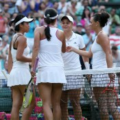 Casey Dellacqua (far right) and Ash Barty (second from right) shake hads with Su-Wei Hsieh (far left) and Peng Shuai after falling 7-6(6) 6-1 in the ladies' doubles final at Wimbledon; Getty Images