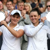 Ashleigh Barty (L) and Casey Dellacqua pose with their runner-up trophies after the ladies' doubles final on Centre Court at Wimbledon; Getty Images