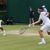 Nick Kyrgios (left) and Thanasi Kokkinakis during their quarterfinal victory in the Wimbledon 2013 boys' doubles championships. GETTY IMAGES