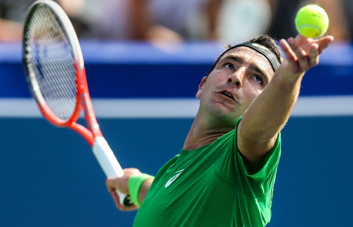 Marinko Matosevic prepares to serve against Ryan Harrison at the BB&T Atlanta Open; Getty Images