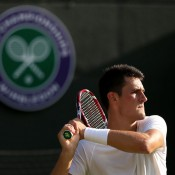 Bernard Tomic during his fourth-round loss to Tomas Berdych, Wimbledon, London, 2013. GETTY IMAGES