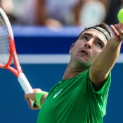 Marinko Matosevic serves against Ryan Harrison in the first round of the BB&T Atlanta Open; Getty Images