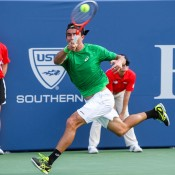 Marinko Matosevic runs for a forehand against Ryan Harrison in their first round match at the BB&T Atlanta Open, a match in which he dropped the first set but came back to win the second; Getty Images