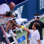 Ryan Harrison shakes hands with the umpire after proving too strong for Marinko Matosevic (with his back turned) at the BB&T Atlanta Open, winning 6-2 2-6 6-3; Getty Images
