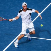 Lleyton Hewitt plays a shot in his first round match against Edouard Roger-Vasselin of France at the BB&T Atlanta Open; Getty Images