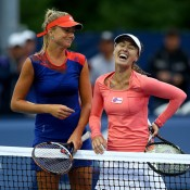 Daniela Hantuchova (L) and the recently-returned Martina Hingis share a laugh after their first round doubles victory at the WTA Rogers Cup in Toronto; Getty Images