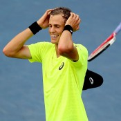 Vasek Pospisil of Canada is overcome with emotion after defeating No.5 seed Tomas Berdych in a third set tiebreak at the ATP Rogers Cup in Montreal, Quebec, Canada; Getty Images