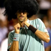 Top seed Novak Djokovic dons a wig and dances for the crowd after defeating Denis Istomin of Uzbekistan in three tight sets in the third round of the ATP Rogers Cup in Montreal, Quebec, Canada; Getty Images