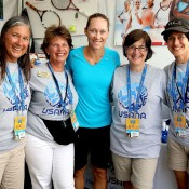 Sam Stosur (centre) proved popular with the fans in Cincinnati, signing autographs and posing for pictures at the Usana booth during the Western & Southern Open; Getty Images