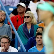 Jimmy Connors (bottom left) watches on in his first - and last - match as coach of Maria Sharapova; the Russian lost in three sets to Sloane Stephens in her opening match at the Western & Southern Open in Cincinnati, Ohio; Getty Images