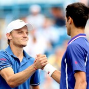 Falling short both in stature and on the scoreboard, Belgian David Goffin (L) shakes hands with Novak Djokovic after falling to the Serb 6-2 6-0 in the third round of the Western & Southern Open in Cincinnati, Ohio; Getty Images