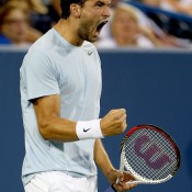 Grigor Dimitrov celebrates animatedly after winning the second set against  Rafael Nadal in their third round match at the Western & Southern Open in Cincinnati; Nadal, however, would go on to win 6-2 5-7 6-2; Getty Images