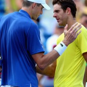 Battle of the big men: John Isner (L) shakes hands with Juan Martin Del Potro after winning their epic semifinal at the Western & Southern Open in Cincinnati, Ohio; Getty Images