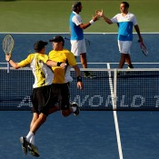 Mike and Bob Bryan celebrate match point against Santiago Gonzalez and Scott Lipsky in the semifinals of the Western & Southern Open in Cincinnati; Getty Images