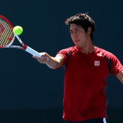 Kei Nishikori of Japan volleys during a practice session ahead of the 2013 US Open; Getty Images