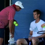 Andy Murray (R) listens to his coach Ivan Lendl during a practice session ahead of the 2013 US Open; Getty Images