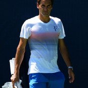 Roger Federer of Switzerland leaves the practice courts after a practice session ahead of the 2013 US Open at USTA Billie Jean King National Tennis Center; Getty Images