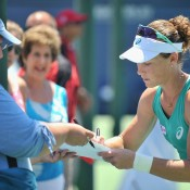 Following her 7-5 6-1 first round victory over Varvara Lepchenko at the WTA Southern California Open, Sam Stosur signs her autograph for a fan; Getty Images