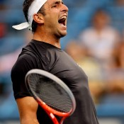 Marinko Matosevic celebrates a career-best victory over 13th-ranked Milos Raonic in the third round of the ATP/WTA Citi Open in Washington, DC; Getty Images