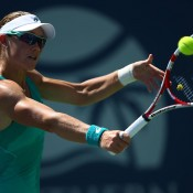 Sam Stosur volleys against Victoria Azarenka in the final of the Southern California Open in Carlsbad, California; Getty Images