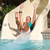 Sam Stosur goes down the ceremonial water slide in celebration of her 6-2 6-3 victory over Victoria Azarenka in the final of the WTA Southern California Open in Carlsbad, California; Getty Images