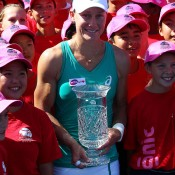 Sam Stosur poses with the trophy and the tournament ball kids after beating Victoria Azarenka of Belarus 6-2 6-3 in the final of the Southern California Open in Carlsbad, California; Getty Images