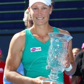 Sam Stosur poses with the trophy after beating Victoria Azarenka 6-2 6-3 in the WTA Southern California Open final in Carlsbad, California; Getty Images