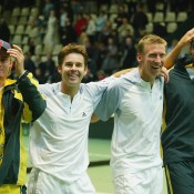 Wayne Arthurs (second from right) and Todd Woodbridge (second from left) of Australia celebrate their win with teammates Mark Philippoussis (R) and Lleyton Hewitt in the 2003 Davis Cup quarterfinals over Sweden in Malmo, Sweden; Getty Images